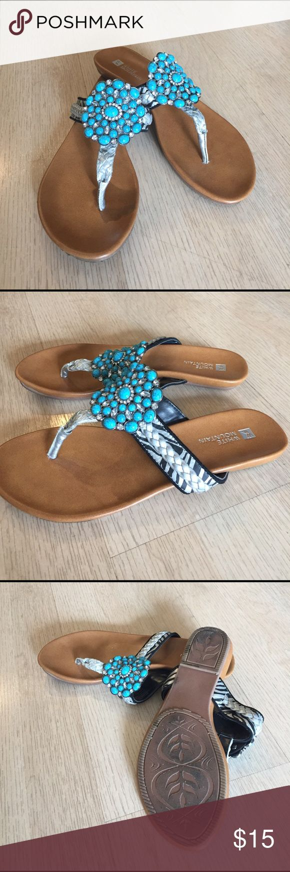 White mountain turquoise jeweled flat shoe White mountain flat with cute turquoise and crystal stones. Sides are braided silver w black and silver print. white mountain Shoes Flats & Loafers