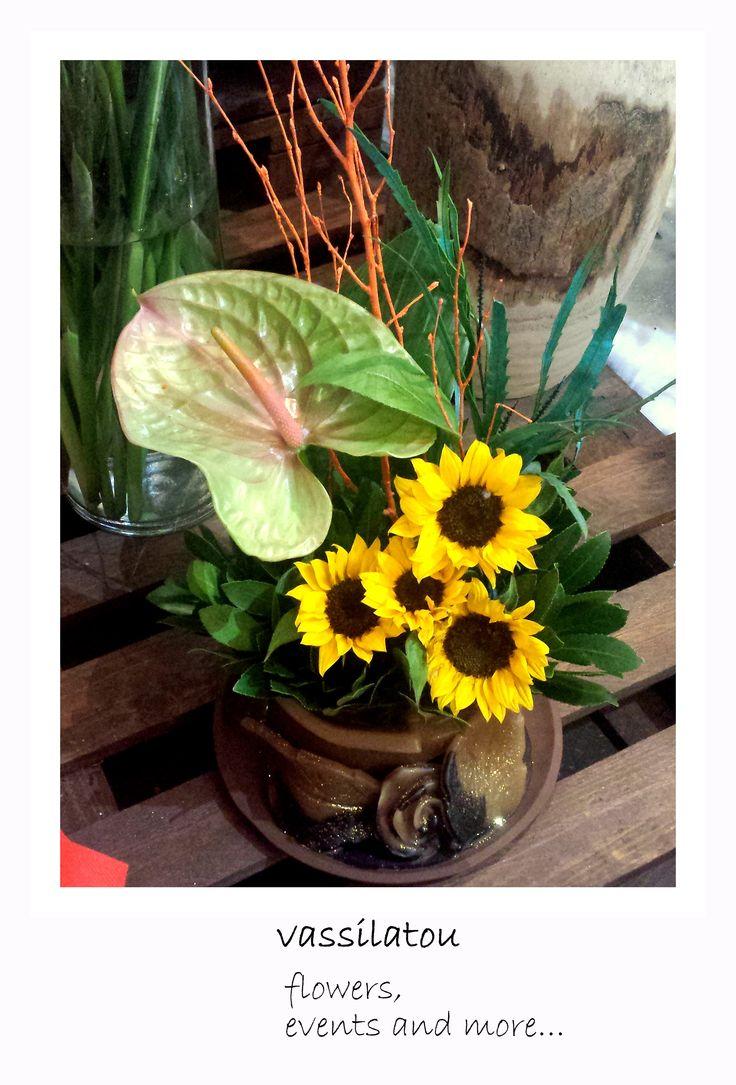 Flower arrangement! sunflowers and anthurium!