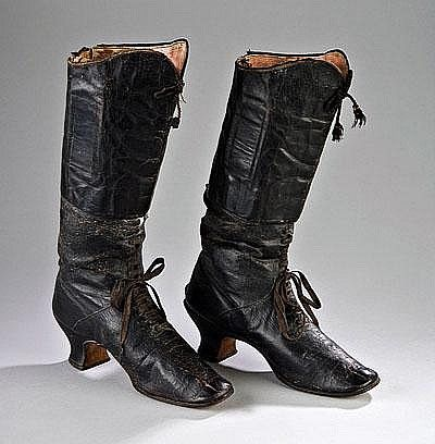 A rare pair of lady's riding boots, 1860s, the legs with stiff upper sections and softer, more malleable leather to the ankles with adjustable lacing, decorative cord piping to the top edges, with straight soles and spur rests on both boots so the rider could ride astride or in a reversible side saddle,(2)   Condition Report:  Foot and upper of boot are in hard leather with soft leather at the ankles. Some cracking to leather where the soft meets the harder leather at the calf area. Straight…