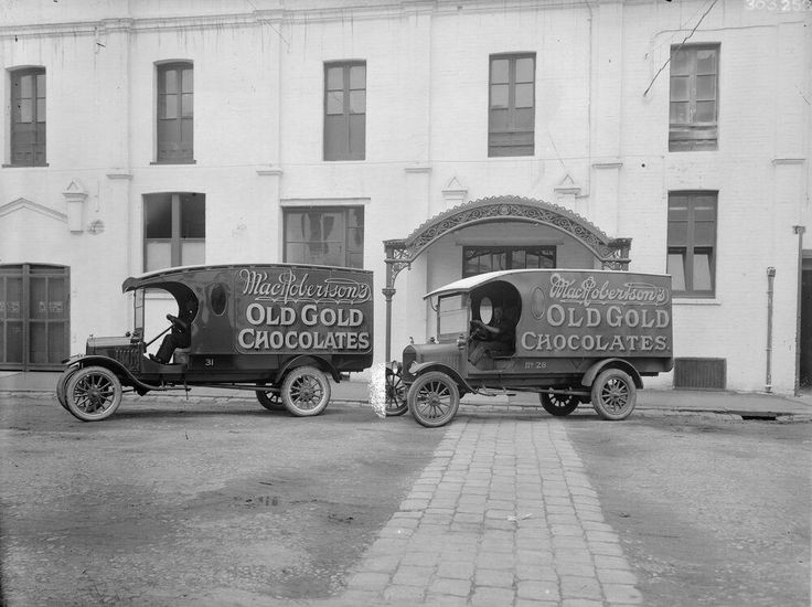 Two delivery vans,nos 28 and 31, for Old Gold chocolates with MacRobertson signage on the side of the van.In front of the MacRobertson Chocolate Factory on Rose St,Fitzroy, Victoria. . •State Library of Victoria•