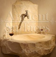 Unique farmhouse style avant-garde rough cleft sink hand carved out of a single antique limestone block ideal for any powder room or wine cellar type of application
