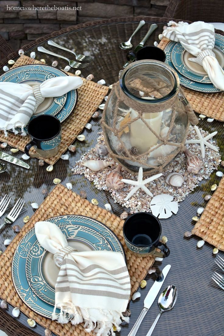 Beach-themed table with shells and Pfaltzgraff Montego dinnerware | homeiswheretheboatis.net