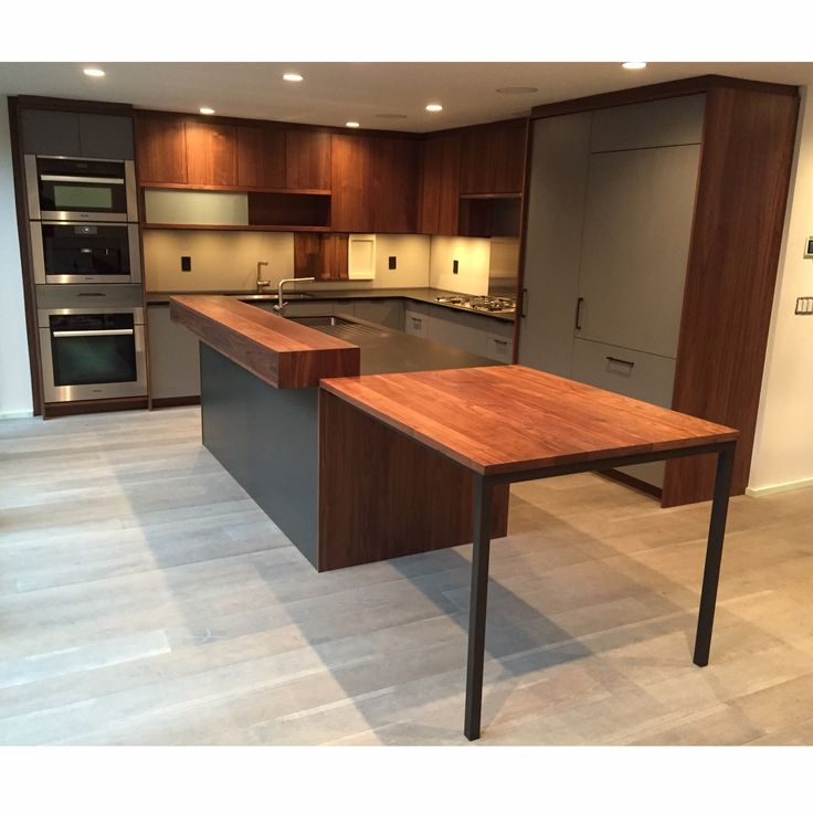 Wide shot of Henrybuilt kitchen. Stile flooring. Appliances by Miele. Installation by myself (A-Frame Constructs crew)