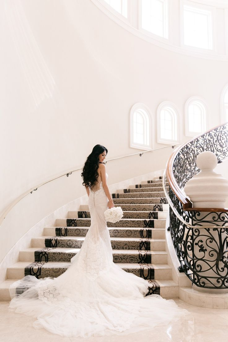 Lisa and Caesar's wedding at the St. Regis Monarch beach, mermaid style Inbal Dror gown, ivory lace, tulle train, ethereal, cascading down staircase, fabulous taste, bridal fashion, hair and makeup, beautiful bridal photos and poses, Jana Williams Photography http://loveluxelife.com/love-lisa-and-caesar-st-regis-monarch-beach/