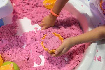 kid playing kinetic sand