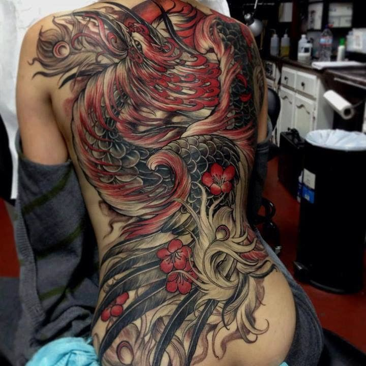 Realistic red phoenix tattoo on full back.. Follow us for more #tattoos