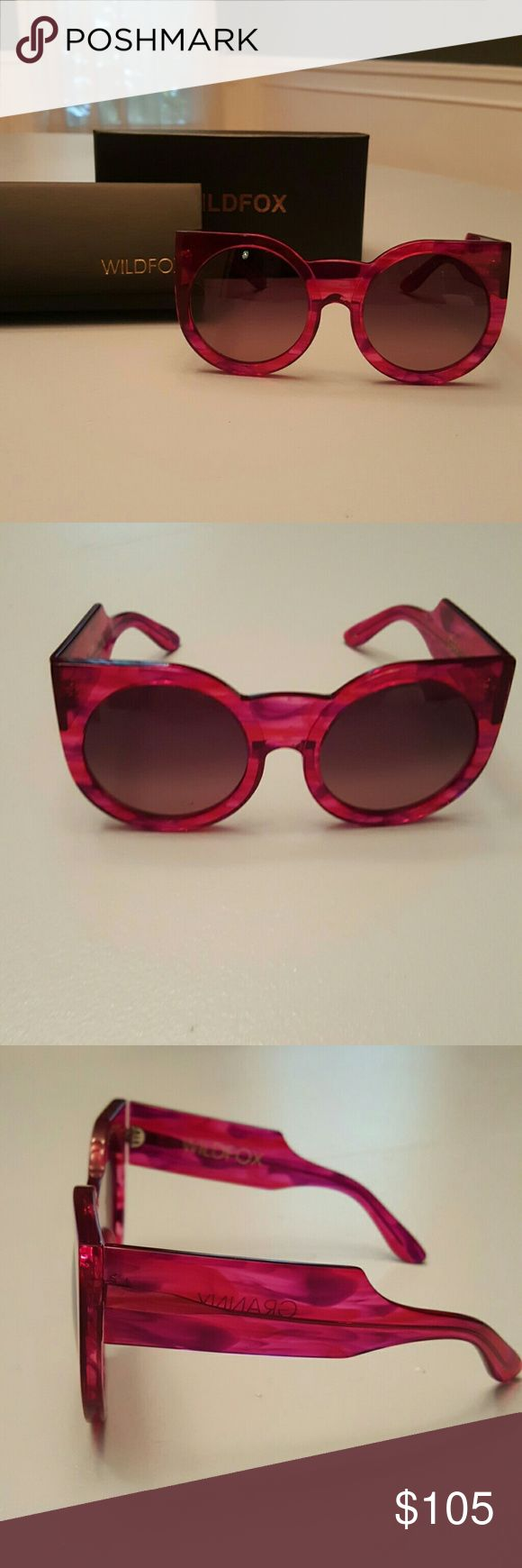 Wildfox Granny Cat Eye Sunglasses Beautiful and brand new Wildfox sunglasses. Depending on the light, they can look deep hot pink, burgundy, purple and all sorts of colors in that range. The style is Granny but with a cute cat eye twist. Oversized style. Perfect condition.  Very hot for Summer!! :) Wildfox Accessories Sunglasses