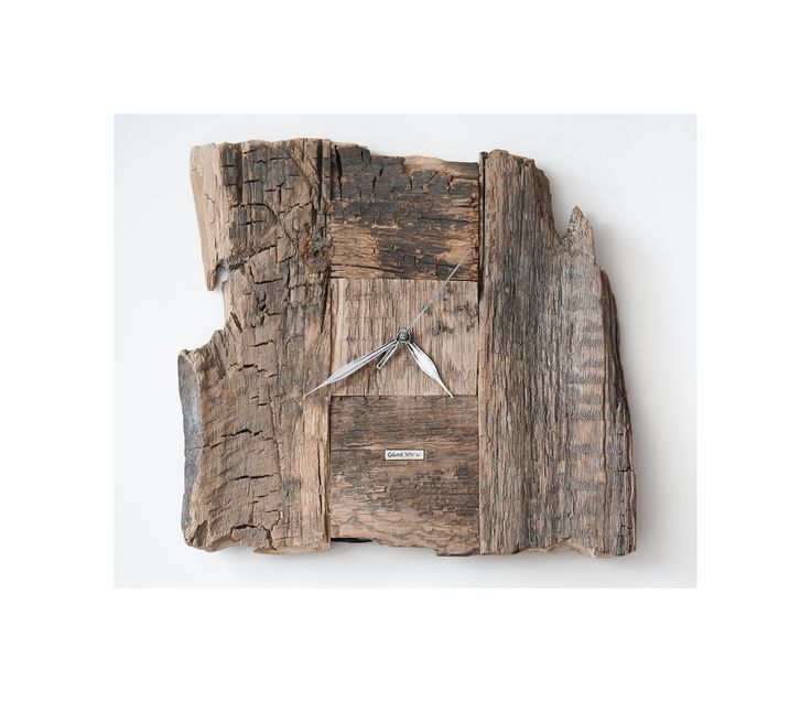 Model no 4. This clock is made of construction wood from the buildings of the Old Town of Gdansk. Black oak dating back to the 14th century. Size: 35 cm x 32 cm.