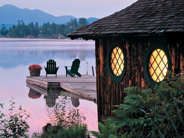 Adirondack chairs on Mirror Lake in the Adirondack Mountains