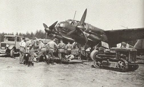 """Finnish Air Force 2./LeLv.44 Junkers Ju-88A """"JK-262″ being armed at Onttola airfield. June 1943."""
