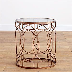 Since I'm obsessed with gold metal side tables but don't want to fork over the cash for the ones I love...I'm thinking this one and a can of gold spray paint will ROCK.  Even just leaving this bronze would be beautiful in any room!