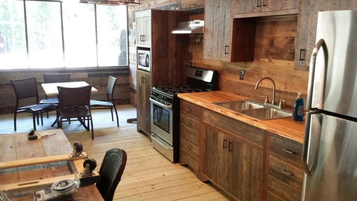 """Here is another shot of the #kitchen we posted previously. We built the reclaimed heart pine #cabinets and provided the """"reclaimed mix"""" skins that are applied to the walls. One more to share soon... 