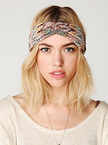 The new look is the thick headband either worn around the head or to pull back! Easy way to make a bad hair day fashionable and pretty. These are sold pretty much anywhere and especially urban outfitters