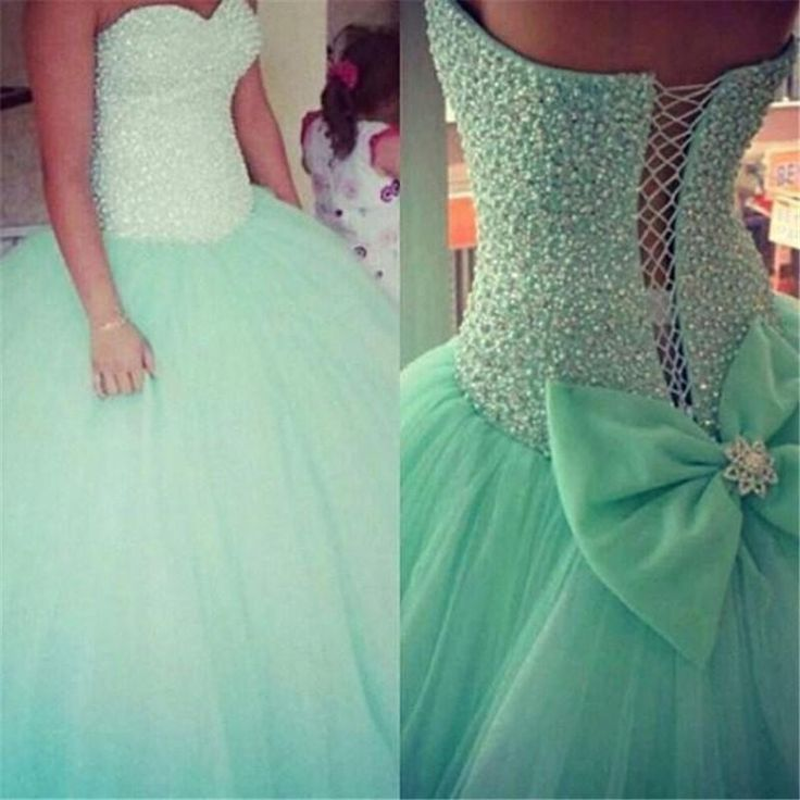 An aqua prom dress with sparkles on the corset, a puffy skirt, and a big bow at the back. Description from pinterest.com. I searched for this on bing.com/images