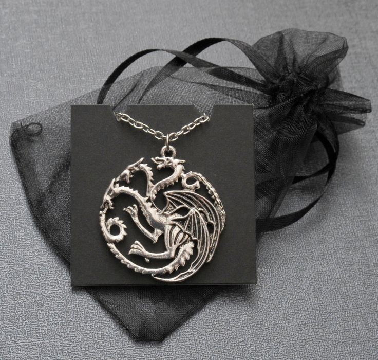 Game of Thrones Daenerys Targaryen dragon necklace – House of Targaryen sigil – silver tone pendant – cosplay prop / accessory by Spookyisland on Etsy https://www.etsy.com/listing/206721343/game-of-thrones-daenerys-targaryen