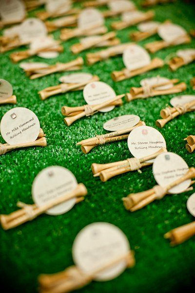golf inspired place cards, each tee has the wedding date and Bride and Grooms names on them