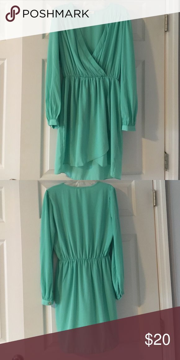 Beautiful aqua colored dress or tunic Silky to the touch. Can be paired with bare legs and heels or leggings and booties. Cinched at the waist so flattering and versatile! Tobi Tops Tunics