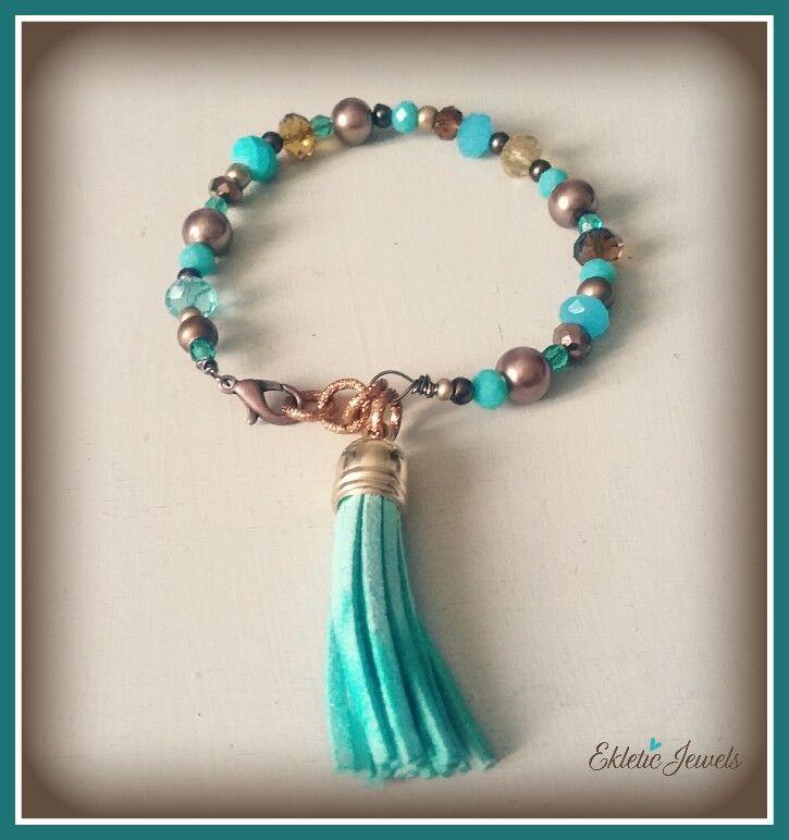 Aqua and bronze boho bracelet made  with crystal beads and tassels