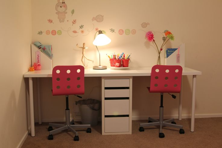 After much searching around on Pinterest I finally landed on this play room set up for my two girls. They LOVE it!  Here is a list of the items, all from Ikea: - JULES Junior desk chair, pink, silver-colour x 2  - LINNMON Table top, white 200cm x 60cm - ADILS Leg, white x 4 - MICKE Drawer unit on castors, white (don't use the casters) - KROBY Work lamp, nickel-plated, glass - KVISSLE Magazine file set of 2, white