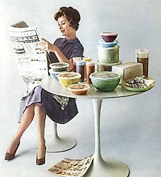 Cute doll idea.  50s Housewife reading her paper next to a table holding her Tupperware collection.
