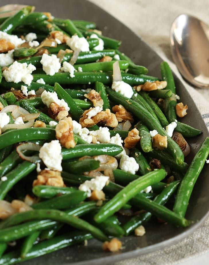 Green beans with goat cheese, shallots and walnuts, a perfect Thanksgiving side dish. Get this vegetarian recipe and more now.