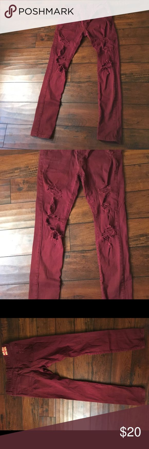 Distressed skinny jeans Super cute distressed maroon skinny jeans Used but great condition Jeans Skinny