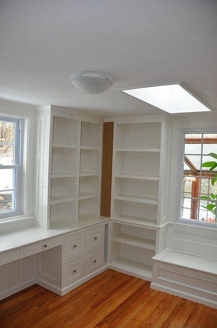 Corner of living room, window either side