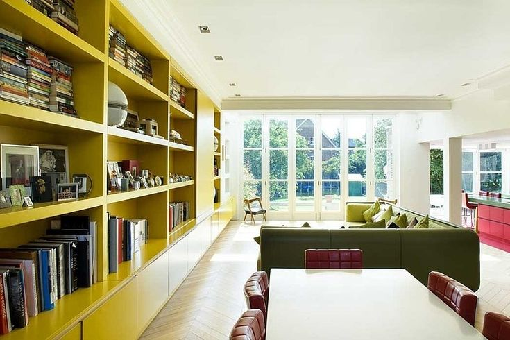 I love the wall of built-in shelving, but personally would choose a different colour | Chevron House by Andy Martin Associates