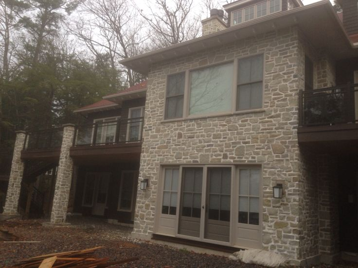 Vancouver limestone with a rough barn style joint. This beautiful cottage is located in Muskoka ontario. The stone work is done by Saunders Stone Design.