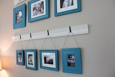 great ideas for paints frames and also this idea to hang multiple frames together you could do this with some crown molding from lowes some hooks and