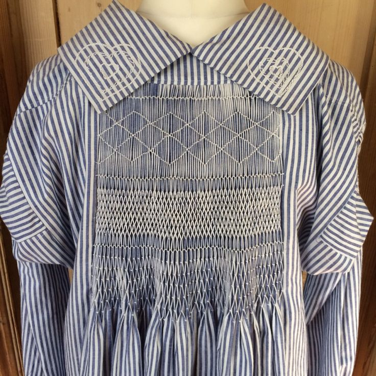 Smock, made to a traditional pattern. Hand smocked and embroidered. Made by Yelling Pig, Cambridgeshire, UK