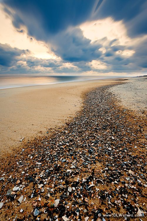 Long Exposure Of A Trail Of Shell Shards Washed Up On The High Tide