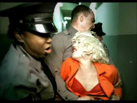 I totally love all the outfits and dresses Gwen wears in this video, well, besides the orange jumpsuit of course.