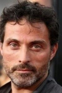 Rufus Sewell. Eerily similar to Kogi.  It's the gaze.