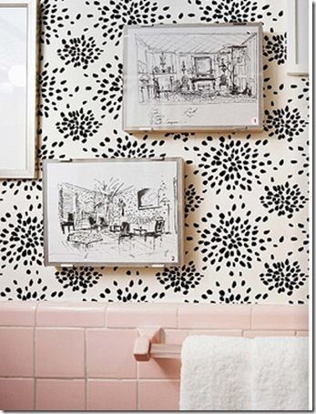 The best improvement to dated/old bathroom tile I've ever seen. This is Fireworks wallpaper by Albert Hadley. The combination  of paper and art manages to make these old tiles look fresh and pretty.