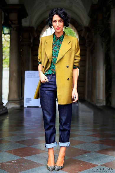 Tailored yellow jacket with bright shirt and jeans on Yasmin Sewell