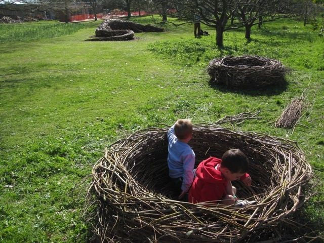 Natural playground idea: huge nests.  Loose parts + recycling the tree trimmings.