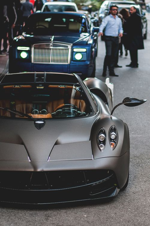 Pagani Huayra & Rolls-Royce Phantom. That rear view mirror is a piece of art in itself.