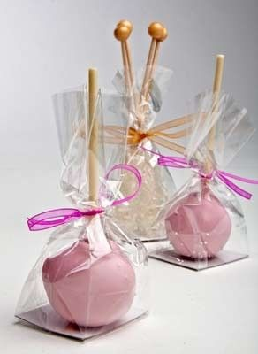 Cake pops in gusseted flat bottom cellophane bags. Good packaging idea for party favors.