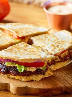 Quesadilla Burgers are crave-able and easy to share. Perfectly seasoned chorizo and gooey melted Chihuahua® cheese make this quesadilla burger delicious and satisfying. #LoveMyQueso