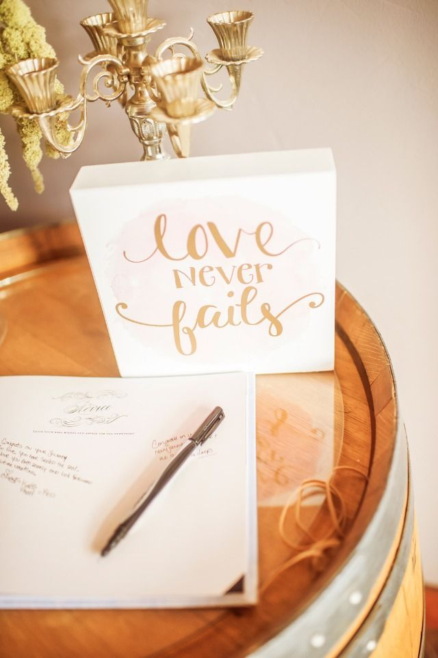 love never fails wedding sign and guest book