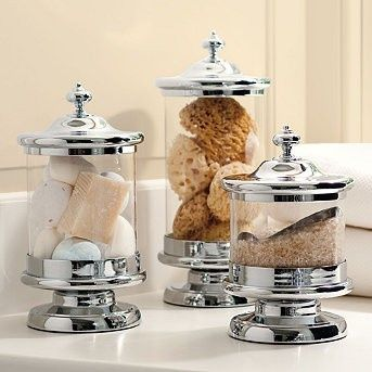 Jars filled with sponges, soaps and bath salts. Would fill with Q tips, cotton balls, and soap