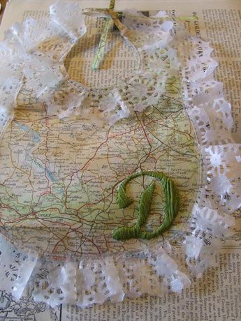 Map bib with paper ruffle and embroidered initial.  No instructions, Pinspiration only.