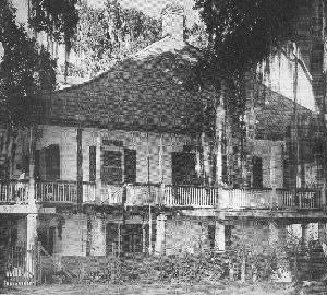 The ghost of a young girl haunts this private plantation, located about thirty-five miles north of Baton Rouge.  Along the double row of trees that leads to the doorstep of Parlange Plantation, the ghost of a young girl in a bridal gown is often seen, her white dress flowing out behind her as she runs. The girl crosses the path and then vanishes, tragically living over again the last moments before her death. Who is she and why does she haunt this place?