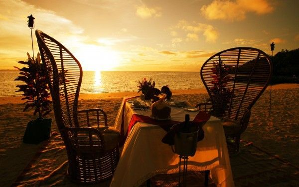 Picturesque romantic place inspired candlelight sunset sea sand flowers mussels idea yellow