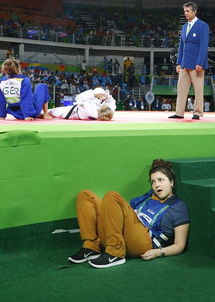 A TV broadcast worker hides to avoid being seen by TV cameras at the Rio de Janeiro Olympic judo tournament on Aug 7 2016