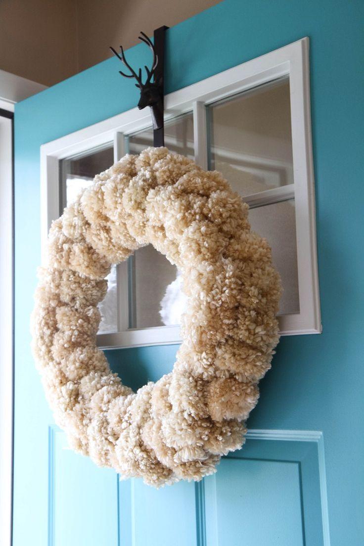 How to Make a Yarn Pom-Pom Wreath from MomAdvice.com