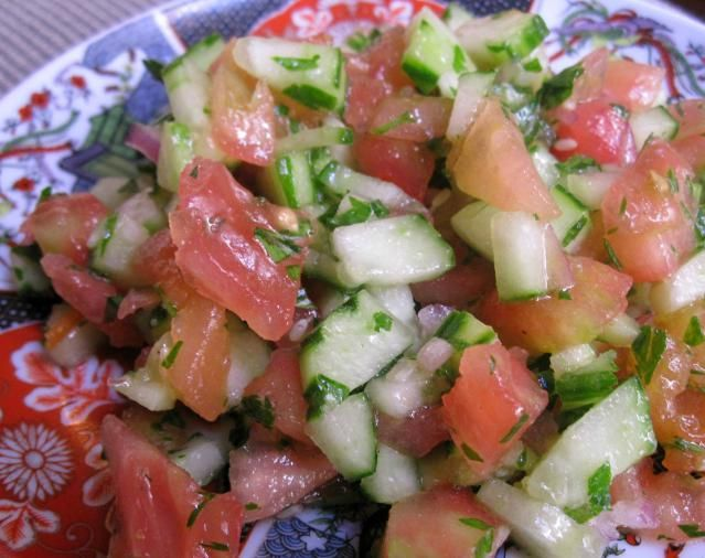 Chopped feggous or cucumber is mixed with tomato and a light vinaigrette.