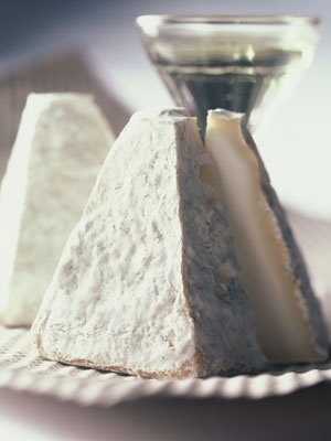 """Pouligny-Saint-Pierre: Fine and bluish French goat's milk. Tender paste, white to ivory colour. Light acidity disappearing when mouthed. Nicknamed the """"Eiffel Tower"""" for being pyramidal in shape x"""