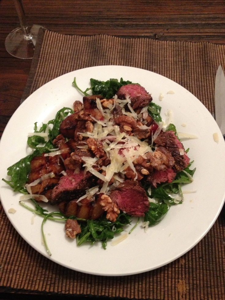 High protein kangaroo and grilled plum salad with walnuts and rocket